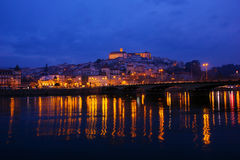 Old town of Coimbra by riverbank, Portugal Stock Photos