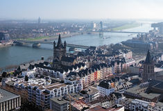 Old Town of Cologne and Rhine river, Germany. View from Cologne Cathedral on Altstadt (Cologne Old Town), Great St. Martin Church, Tower of Old City Hall and the Stock Image