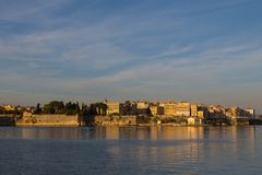 Old town of corfu in morning sun viewed from sea, blue sky. Clouds Royalty Free Stock Photography