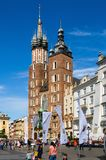 Old town in Cracow, Poland. CRACOW, POLAND - AUGUST 16, 2014: Tourists visiting the main market square in Cracow (Poland), which is one of the most famous and royalty free stock photo