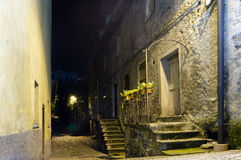 Old town. Dark street and house in old italian town, yellow light from the lantern Royalty Free Stock Image