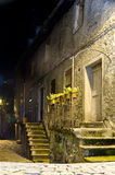 Old town. Dark street and house in old italian town, yellow light from the lantern Stock Images