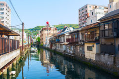 Old Town district in Nagasaki City. Artificial canal flows into the Japanese Sea. Nagasaki, Japan. Stock Photo