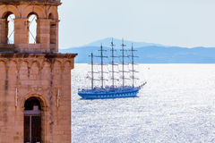 Old town Dubrovnik on the Adriatic Sea background with ship. Stock Image