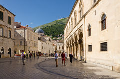 Old Town, Dubrovnik. DUBROVNIK, CROATIA - MAY 15, 2013: People walking down the main street in the old town of Dubrovnik at night. Pedestrian zone in an old Royalty Free Stock Image