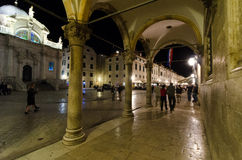 Old Town, Dubrovnik, Croatia. DUBROVNIK, CROATIA - MAY 16, 2013: People walking down the main street in the old town of Dubrovnik at night. Pedestrian zone in an Stock Photos