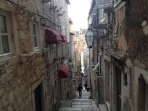 Old town in Dubrovnik Croatia. Narrow alley with old houses in Dubrovnik Croatia Royalty Free Stock Photos