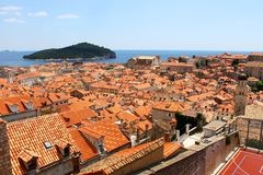 Old town of Dubrovnik near the sea, roof tops. View over Dubrovnik old town from Croatia, surrounded by the blue Mediterranean Sea, island at the back Royalty Free Stock Photography