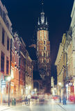 Old Town in the evening, Krakow. KRAKOW, POLAND - SEPTEMBER 15 2015: Night lights of Florianska street with a view of St. Marys Basilica, Krakow Old Town Stock Images