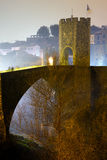 Old  town with gate on bridge in night time.  Besalu Royalty Free Stock Photography