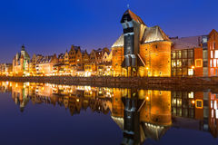 Old town of Gdansk with ancient crane at night Stock Photos