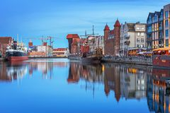 Old town in Gdansk and catwalk over Motlawa river at dusk. GDANSK, POLAND - JUNE 21, 2017: Old town in Gdansk over Motlawa river at dusk, Poland. Gdansk is the Royalty Free Stock Photos