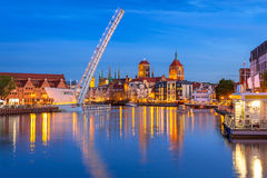 Old town in Gdansk and catwalk over Motlawa river at dusk Royalty Free Stock Image