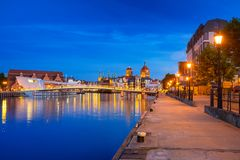 Architecture of the old town in Gdansk. Old town in Gdansk and catwalk over Motlawa river at dusk, Poland Royalty Free Stock Photography