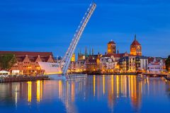 Old town in Gdansk and catwalk over Motlawa river at dusk. Poland Royalty Free Stock Photo