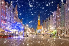 Old town of Gdansk on a cold winter night with falling snow. Poland royalty free stock photography