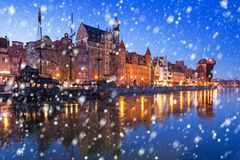 Old town of Gdansk on a cold winter night with falling snow. Poland royalty free stock photos