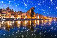 Old town of Gdansk on a cold winter night with falling snow. Poland royalty free stock images