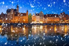 Old town of Gdansk on a cold winter night with falling snow. Poland stock photo