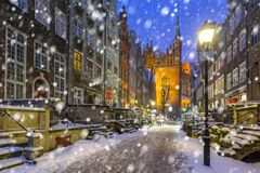 Old town of Gdansk on a cold winter night. With falling snow, Poland Stock Image