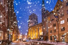 Old town of Gdansk on a cold winter night. With falling snow, Poland Royalty Free Stock Photography