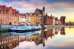 Old town of Gdansk at Motlawa river. Beautiful old town of Gdansk reflected in Motlawa river at sunrise, Poland Royalty Free Stock Photos