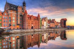 Old town of Gdansk at Motlawa river. Beautiful old town of Gdansk reflected in Motlawa river at sunrise, Poland Stock Images