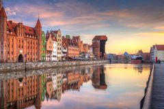 Old town of Gdansk at Motlawa river. Beautiful old town of Gdansk reflected in Motlawa river at sunrise, Poland Stock Image