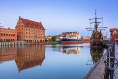 Old town in Gdansk over Motlawa river at dusk, Poland. GDANSK, POLAND - JUNE 21, 2017: Old town in Gdansk over Motlawa river at dusk, Poland. Gdansk is the Stock Photo