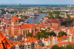 Old Town of Gdansk, Poland. Aerial view of Old Town with St. John church and Motlawa River, harbor, ship yard and Baltic Sea in the summer morning, Gdansk stock photos