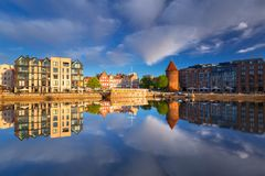 Old town of Gdansk reflected in the Motlawa river at sunrise, Poland. Stock Photography