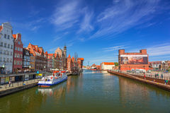 Old town of Gdansk with reflection in Motlawa river. GDANSK, POLAND - MAY 11, 2015: Old town of Gdansk with reflection in Motlawa river. Gdansk is the historical Royalty Free Stock Photography