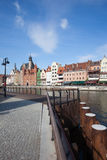 Old Town of Gdansk From River Promenade. Promenade along Motlawa River and Old Town skyline in city of Gdansk, Poland Royalty Free Stock Photo