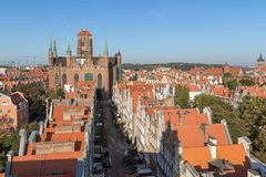 Old Town in Gdansk viewed from above. Old residential buildings, Mariacka Street and St. Mary`s Church at the Main Town Old Town in Gdansk, Poland, viewed from Royalty Free Stock Photos
