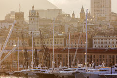 Old town in Genoa accross the harbor Royalty Free Stock Images
