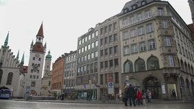 Old Town Hall attracting tourists on beautiful St. Mary Square, Munich, Germany stock footage