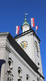 old town hall with flags of the Austrian city of Salzburg Royalty Free Stock Image