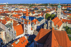 Old Town Hall and Heiliggeistkirche, Munich, Germany. Heiliggeistkirche is a Gothic hall church in Munich, southern Germany, originally belonging to the Hospice stock image