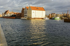 The Old Town and Harbor of Gdansk by the river Motlawa. Stock Photo