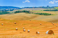 Old town and hay bales in Tuscany,Italy,Europe Stock Photos