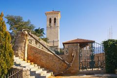 Old Town of Herceg Novi on sunny winter day. Bell tower of Saint Jerome Church. Montenegro stock photography