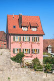 Old town house with pink shingles Stock Images