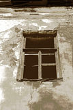 Old town house. Sepia window in the wall. Stock Image