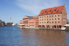Old town houses and street cafes over Motlawa river in Gdansk, P Stock Photos