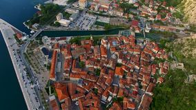 The old town of Kotor. Flying over the city. Aerial survey by a stock video footage