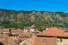 The Old Town of Kotor in Montenegro. View of tiled roofs of old town ang the church from the fortress on the hill in Kotor, Montenegro Stock Photo