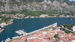 Old town Kotor and port with yachts