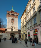 Old Town Krakow. Barbican Gate entry to the Old Town Krakow with McDonald's adjacent, streets filled with tourists Royalty Free Stock Photography