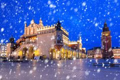 Old town of Krakow on a cold winter night with falling snow. Poland royalty free stock photos