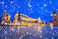 Old town of Krakow on a cold winter night with falling snow. Poland royalty free stock images
